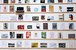 © Licensed to London News Pictures. 08/04/2016. The Royal College of Arts(RCA) 22nd annual Stewarts Law RCA Secret exhibition of postcards designed by well-known artists and designers. London, UK. Photo credit: Ray Tang/LNP