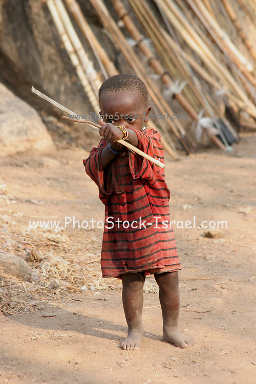 Africa, Tanzania, members of the Datoga tribe Child playing with bow and arrow