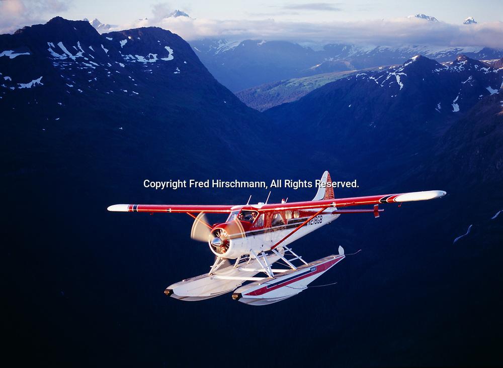 Cordova Air Service's de Havilland DHC2 Beaver flying through Chugach Mountains northeast of Beartrap Bay, Prince William Sound, Alaska.