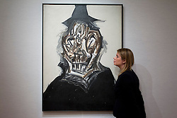 © Licensed to London News Pictures. 08/10/2012. LONDON, UK. A member of Bonhams staff views Spanish artist Antonio Saura's 'Retrato Imaginario de Felipe II' (1984) (est. GB£120,000-160,000) ahead of a sale at the auction house's New Bond Street premises. The auction, featuring a collection of contemporary art and design is set to take place on Thursday the 11th of October at Bonham's New Bond Street auction house. Photo credit: Matt Cetti-Roberts/LNP