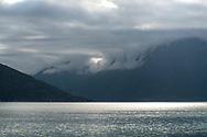 Low hanging clouds over mountains surrounding Hardanger Fjord, Vestlandet, Norway, Europe