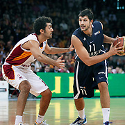 Anadolu Efes's Cenk AKYOL (R) during their BEKO Basketball League derby match Galatasaray between Anadolu Efes at the Abdi Ipekci Arena in Istanbul at Turkey on Sunday, November 13 2011. Photo by TURKPIX