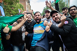 © Licensed to London News Pictures. 16/06/2019. Manchester, UK. Fans dance and sing during a break in play . Cricket fans watch India play Pakistan on a live screen in Cathedral Gardens , as the the two sides meet in the ICC Cricket World Cup at Old Trafford . Photo credit: Joel Goodman/LNP