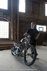 Paul Cox with his Guillotine, his Born Free-6 custom 1977 HD open Rocker Shovel in his wife Ann's R.H. Smith Mercantile building. Port Jervis, NY. USA. Monday June 11, 2018. Photography ©2018 Michael Lichter.