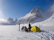A climber camps out near the Kitchatna Spires, Alaska