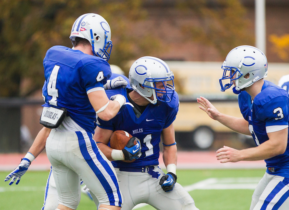 Zach Padula, Dan Maddox, and Phil Amato, of Colby College, after Padula intercepted a pass in an NCAA Division III college football game at Seaverns Field at Harold Alfond Stadium, Saturday Oct. 20, 2012 in Waterville, ME. (Dustin Satloff/Colby College Athletics)