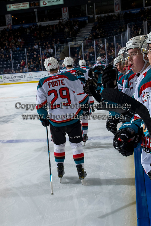 KELOWNA, CANADA - FEBRUARY 6: Nolan Foote #29 of the Kelowna Rockets celebrates a goal with fist bumps past the bench against the Spokane Chiefs on February 6, 2019 at Prospera Place in Kelowna, British Columbia, Canada.  (Photo by Marissa Baecker/Shoot the Breeze)