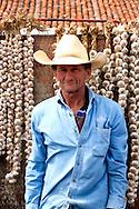 Man selling garlic in Gibara, Holguin, Cuba.