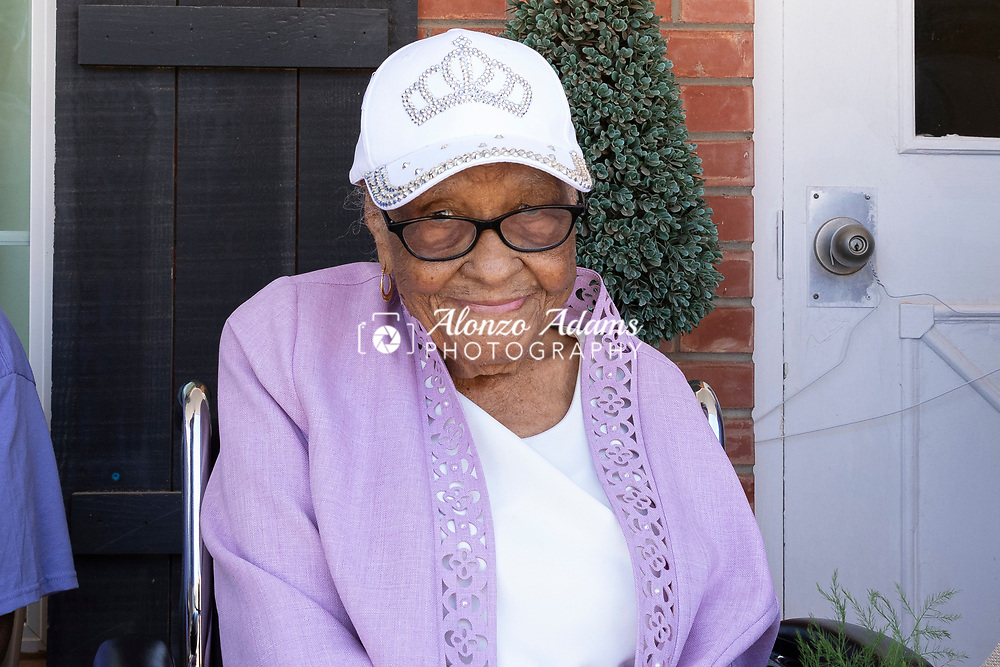 Ethel M. Bowens poses for a photo following a parade outside of the Golden Age Nursing Home celebrating her 112th birthday and being named the oldest living Oklahoman in Guthrie, Okla. on Saturday, Aug. 21, 2021. Photo by Alonzo J. Adams.