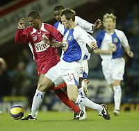 Photo: Aidan Ellis.<br /> Blackburn Rovers v AS Nancy. UEFA Cup. 13/12/2006.<br /> Rovers Andre Ooijer stops Nancy's KIM
