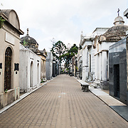 La Recoleta Cemetery is a famous cemetery in the Recoleta neighborhood of Buenos Aires and is famous for being the burial sites of Eva Peron, Argentinian presidents, and other notables. The cemetery features above-ground gravesites and crypts and is organized into a series of streets and boulevards.