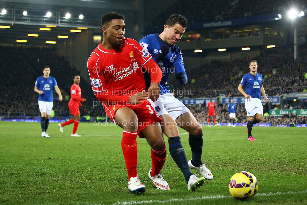 Jordon Ibe of Liverpool and Bryan Oviedo of Everton battle for the ball. Barclays Premier league match, Everton v Liverpool at Goodison Park in Liverpool, Merseyside on Saturday 7th February 2015<br /> pic by Chris Stading, Andrew Orchard sports photography.