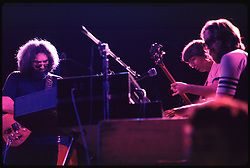 Jerry Garcia, Phil Lesh and Keith Godchaux. Grateful Dead in Concert at the Huntington Civic Center, Huntington West Virginia on 16 April 1978. Image No. 78C16-11