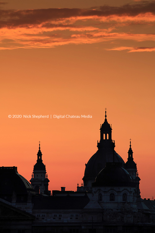 The dome and minarets of St Stephen's Basilica at dawn in Budapest, Hungary.