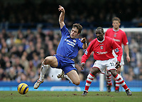 Photo: Lee Earle.<br /> Chelsea v Charlton Athletic. The Barclays Premiership. 22/01/2006. Chelsea's Joe Cole (L) is watched by Chris Powell.