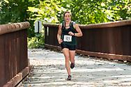 Rosendale, New York  - Sierra Jech, the women's winner in the 13.1-mile race, crosses the Rosendale Trestle near the end of fhe Shawangunk Ridge Trail Run/Hike on Sept. 16, 2017.