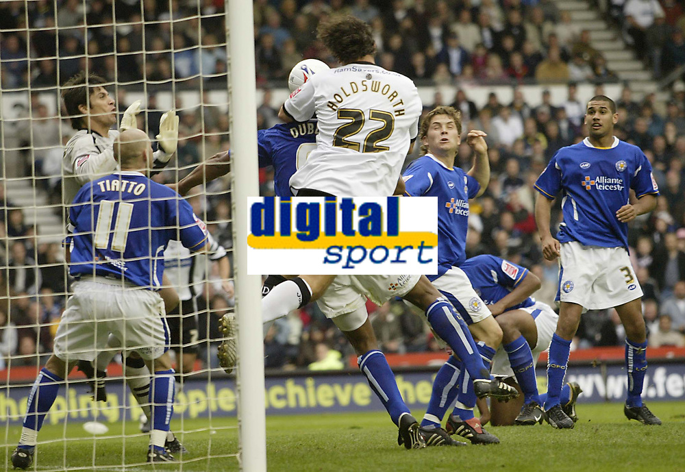 Photo: Aidan Ellis.<br /> Derby County v Leicester City. Coca Cola Championship. 01/10/2005.<br /> Derby's Dean Holdsworth challenges for an aerial ball in the Leicester penalty box