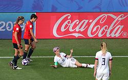 USA's Megan Rapinoe (centre) on the floor