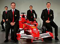 Ferrari drivers Michael Schumacher (R), Rubens Barrichello (L), test drivers Marc Gene (L2) and Luca Badoer (R2) with the new F2005 F1 car at the team's headquarters in Maranello<br /> <br /> <br /> <br /> Photo Munch / Graffiti