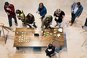 """Patrons sample dishes during the """"Garver Gourmet"""" hosted by Sitka Salmon Shares at the newly opened Garver Feed Mill event space in Madison, Wisconsin, Saturday, Sept. 7, 2019."""