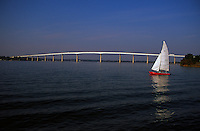 Solomons Island, Maryland--a catermeran sets sail on the Patuxent river near the mouth of the Chesapeake Bay. The Governor Thomas Johnson Bridge, background, was built in 1977. The bridge leads from just off Solomons Island proper to Saint Mary's County, Maryland.