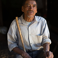 """Jesus the Seed Saver<br /> <br /> Jesús Martínez, Quiscamote, Santa Elena, La Paz<br /> <br /> """"I don't remember how old I am. I remember the war. We heard it all happening - the bombs and machine guns, but they never arrived here. Thank God.<br /> <br /> Jesus' son, who is also a Jesus - Jesús Martínez Vásquez - shows us some multi-coloured corn they are saving for seed. These are open-pollinated varieties of indigenous corn. <br /> <br /> These are seeds that are passed down from generation to generation. Farmers have done this for thousands of years. We save the seeds from the best heads of corn, then we plant them again, when the moon is right, and we'll get a good harvest of strong corn like the harvest before, as long as it rains.<br />  <br /> We grow black corn, yellow and white, and mixed. We know that the seeds from here like our mountain soil. Corn has grown here in these mountains for hundreds of years. The first problem with the commercial corn seed is that you have to buy them. Well, we don't have the money. It is very productive, but only the first year, then the second year it's weaker. It's so weak it's not worth saving the seed for the second year.  <br /> <br /> If you want to keep on getting the big hybrid yield, then you need to buy more seed the next year, and the fertilizer and the insecticide. And if you don't keep your indigenous seeds, then you just have to buy the hybrid seed. So, the best thing is to grow at least some indigenous corn, and keep the seed, or you end up dependent on the seed companies and giving your money to them. Anyway, this is what we use for the tortillas. We eat these with beans, an egg, avocado. We grow two types of beans here, a tiny one and Chinapopo. That's a tasty bean."""""""