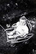overhead view of toddler sitting in stroller France 1900s