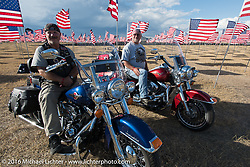 With more than 50 years of combined military service between them, Dan Johns (wearing vest), a retired Michigan Army National Guard (MIARNG) Master Sergeant, with his brother, Roger Johns, a retired MIARNG Captain at the Buffalo Chip Field of Flags during the annual Sturgis Black Hills Motorcycle Rally. SD, USA, August 12, 2016.