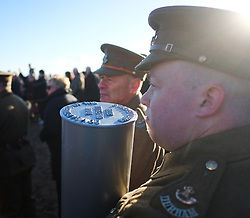 © Licensed to London News Pictures. <br /> 16/12/2014. <br /> <br /> Hartlepool, United Kingdom<br /> <br /> Members of the 18th Battalion The Durham Light Infantry Commemoration Society prepare to carry a time capsule to be buried during an event to commemorate the bombardment of Hartlepool by German warships during World War One. During the bombardment 130 civilians were killed and more than 500 were wounded. The Headland's Heugh Gun Battery returned fire in what was the only battle to be fought on British soil during World War One, and one of the Battery's soldiers, Theo Jones of the Durham Light Infantry, became the first British soldier to be killed by enemy action on home ground in the war.<br /> <br /> Photo credit : Ian Forsyth/LNP