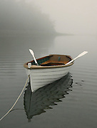 """A 1930s wood lapstrake dinghy, named """"Fred,"""" rests on the beach near Little Sucia Island in the San Juan Islands. (Greg Gilbert / The Seattle Times)"""