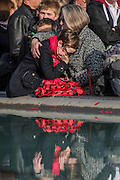 A child is comforted after the two minutes silence - Silence in the Square oraganised by the British Legion in Trafalgar Square  - 11 November 2016, London.