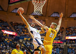 Nov 24, 2018; Morgantown, WV, USA; West Virginia Mountaineers forward Esa Ahmad (23) shoots in the lane while defended by Valparaiso Crusaders center Derrik Smits (21) during the second half at WVU Coliseum. Mandatory Credit: Ben Queen-USA TODAY Sports