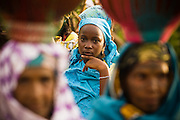 Refugee teenage girls watch during the visit of UNICEF Goodwill Ambassador Mia Farrow in the village of Boulembe, near Bertoua, Cameroon, on Tuesday September 15, 2009..