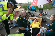 12 local activists locked themselves in specially made arm tubes to block the entrance to Quadrillas drill site in New Preston Road, July 03 2017, Lancashire, United Kingdom. Medics attending Alana MMcCullogh are asked to attend another, hurt by police. The 13 activists included 3 councillors; Julie Brickles, Miranda Cox and Gina Dowding and Nick Danby, Martin Porter, Jeanette Porter,  Michelle Martin, Louise Robinson,<br /> Alana McCullough, Nick Sheldrick, Cath Robinson, Barbara Cookson, Dan Huxley-Blyth. The blockade is a repsonse to the emmidiate drilling for shale gas, fracking, by the fracking company Quadrilla. Lancashire voted against permitting fracking but was over ruled by the conservative central Government. All the activists have been active in the struggle against fracking for years but this is their first direct action of peacefull protesting. Fracking is a highly contested way of extracting gas, it is risky to extract and damaging to the environment and is banned in parts of Europe . Lancashire has in the past experienced earth quakes blamed on fracking.