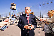 """27 FEBRUARY 2012 - PHOENIX, AZ:    Maricopa County Sheriff JOE ARPAIO talks about the new sign he unveiled at """"Tent City"""" in the Maricopa County Jail system. The new sign announces the number of inmates who have """"served"""" time in the county jail's tents. Sheriff Arpaio opened """"Tent City"""" with surplus US Army tents from the Korean War in 1993. The tents, which are not air conditioned, house about 2,000 county inmates at any given time. Monday's announcement is the kickoff event of the Sheriff's celebration of 19 years of Tent City. The sign Arpaio  announced Monday is based on the sign a popular fast food chain used to use to mark the number of hamburgers served.  PHOTO BY JACK KURTZ"""