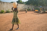 Children fetch water from the pump located in ICDI office in PK 11, Bangui.