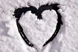 Snow comes to Norwich, UK February 2021. Heart on car window