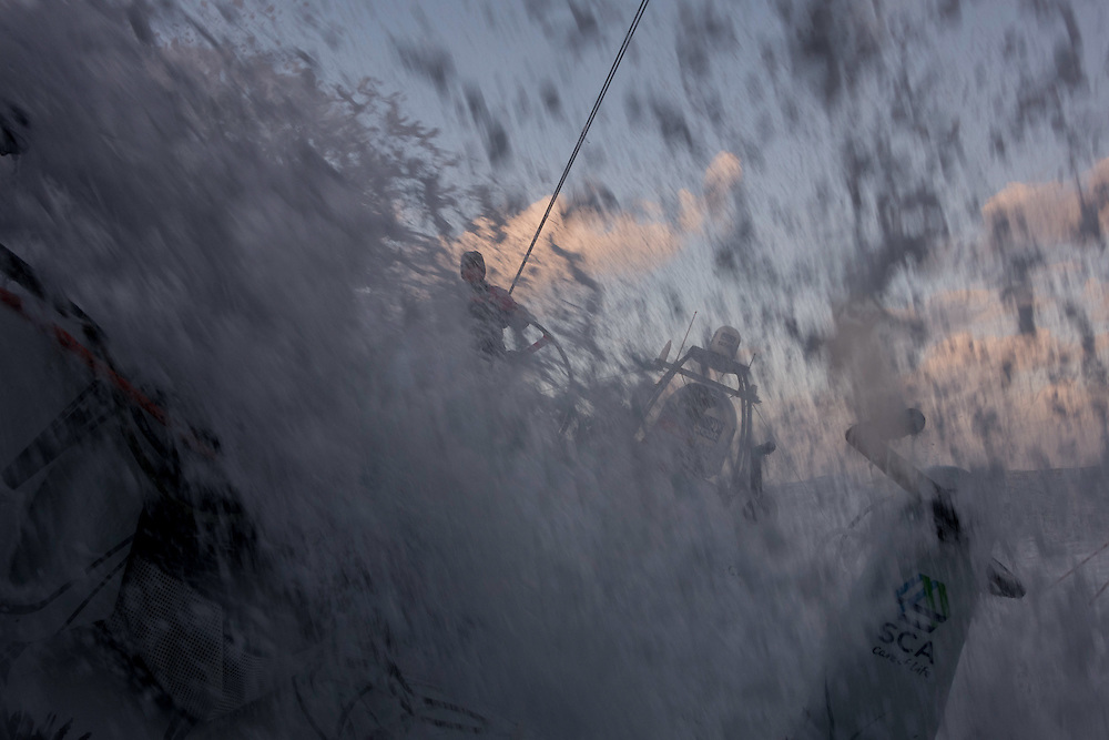 November 21, 2014. Leg 2 onboard Team SCA. A wave crashes over the hatch of Team SCA at sunrise.