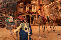 Bedouin man with his camels, with the Treasury monument behind, Petra Archaeological Park, Petra, Jordan.