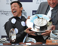 Flat Horse Racing - 2019 Investec Derby Festival - Friday, Day One (Ladies Day)<br /> <br /> Frankie Dettori on Anapurna celebrates with the Oaks trophy, in the 16.30 investec Oaks (Group 1), at Epsom Racecourse.<br /> <br /> COLORSPORT/ANDREW COWIE