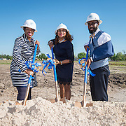 LaShonda Bilbo-Ervin, left, Houston ISD Trustee Rhonda Skillern-Jones, center, and Carlos Phillips, right, participate in ground breaking ceremonies at Washington High School, April 5, 2016.