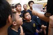 KungFu Dragon USA students receive a pep-talk before performing a Dragon dance during the Lunar New Year event at the Great Mall of the Bay Area in Milpitas, California, on February 21, 2015. (Stan Olszewski/SOSKIphoto)