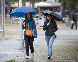 © Licensed to London News Pictures. 14/05/2015. Bristol, UK. Two woman with umbrellas braving the wet weather in Bristol city centre today, Thursday 14th May 2015. Photo credit : Rob Arnold/LNP