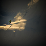 Tyler Hatcher drops into a steep line in the Cascade backcountry during early morning light.