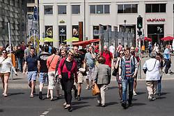 View of pedestrians crossing street at Potsdamer Platz in Berlin Germany