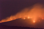 San Antonio Fire burns along a ridge on the evening of June 14, 2018, with the light from ground fires lighting up the smoke dramatically. Valles Caldera National Preserve, © 2018 David A. Ponton