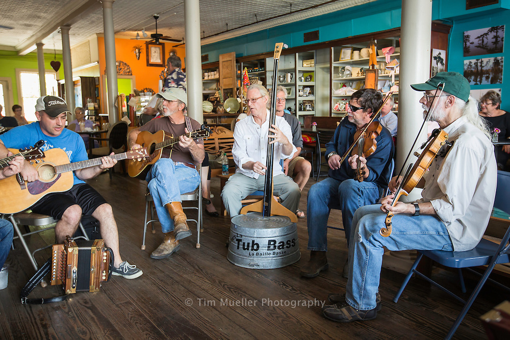 Musicians, from left, Ryan Simon, Larry Babineaux, Niel Nathason, Blane Fruge and John Palmas meet at Joie de vivre coffee shop Saturday morning in Breaux Bridge, La. The Cajun music jam sessions are offered at 11 am Saturdays with a children's jam session every third Sunday.