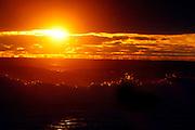 Sunset on the Destin, Florida beach as large waves crash ashore.