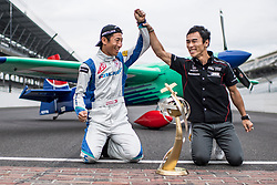 Yoshihide Muroya of Japan poses for a photograph with 2017 Indy 500 winner and former Formula 1 driver Takuma Sato of Japan after he won at the eighth round of the Red Bull Air Race World Championship at Indianapolis Motor Speedway, United States on October 15, 2017. // Joerg Mitter / Red Bull Content Pool // P-20171016-00099 // Usage for editorial use only // Please go to www.redbullcontentpool.com for further information. //