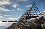 Wooden structures for drying local cod, seen just outside Henningsvaer, Lofoten Islands